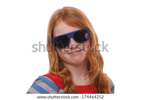 Portrait of a red-haired young girl wearing sunglasses on white background - stock photo