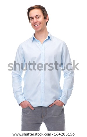 Portrait of a relaxed young man smiling on isolated white background