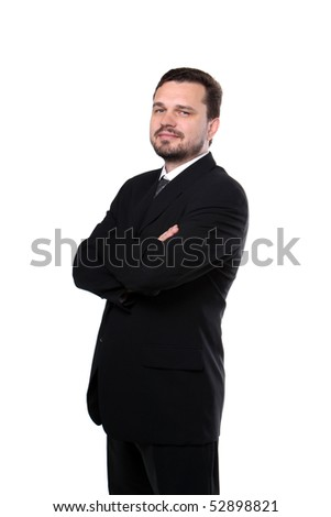 Portrait of a representative smiling business man standing with crossed arms - stock photo