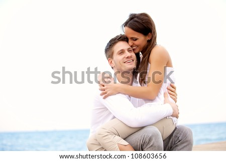 Portrait of a romantic couple enjoying each other's company in their vacation on a beach - stock photo