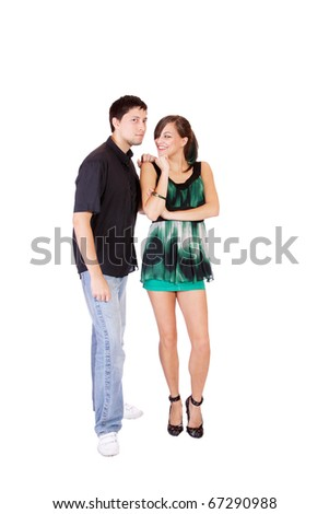 Portrait of a romantic young couple standing together over white background - stock photo