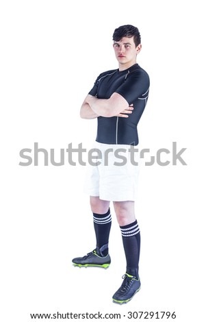 Portrait of a rugby player with arms crossed on a white background