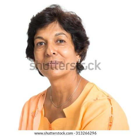 Portrait of a 50s Indian mature woman smiling, isolated on white background. - stock photo