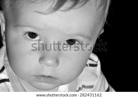Portrait of a sad child in monochrome - stock photo