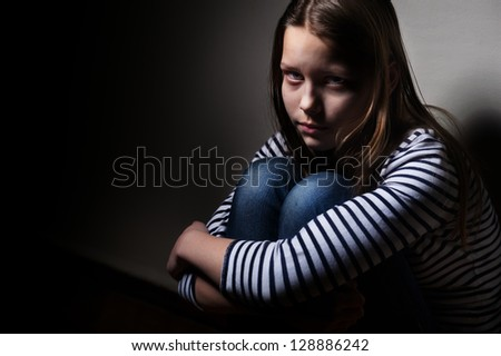 Portrait of a sad little girl - stock photo