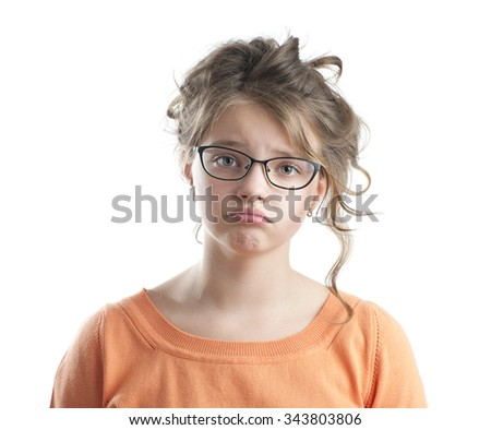 Portrait of a sad little girl. Studio photography on a white background. Age of child 10 years. - stock photo
