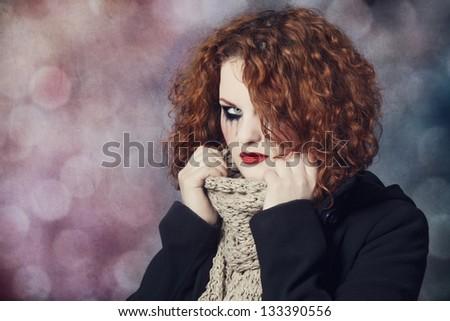 Portrait of a sad redhead. - stock photo