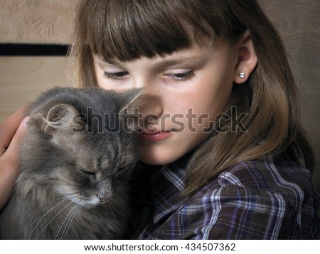 Portrait of a sad teenage girl with gray cat