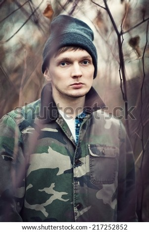 portrait of a sad young man outdoors . - stock photo