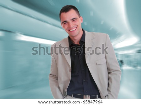 Portrait of a salesman at the shopping mall - stock photo