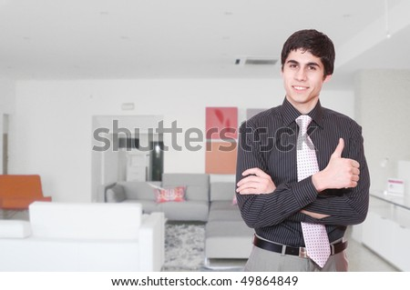 Portrait of a salesman in the furniture store - stock photo
