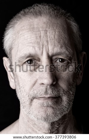Portrait of a satisfied and confident man with a penetrating gaze - stock photo