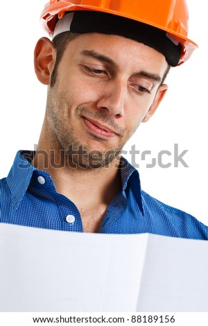 Portrait of a satisfied engineer looking at a drawing - stock photo