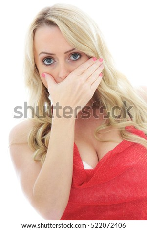 Portrait of a Scared and Shocked Girl Looking at the Camera Against a White Background
