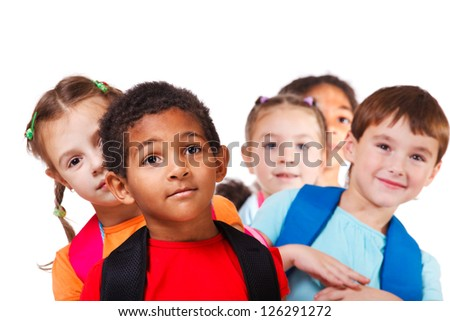 Portrait of a school aged African American boy and his friends behind - stock photo