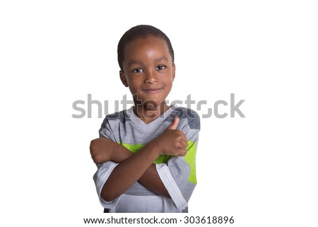 Portrait of a school aged child giving a thumbs up isolated on white