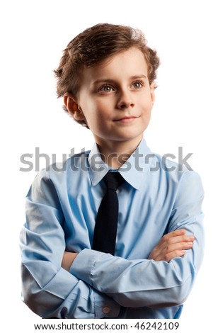 Portrait of a schoolboy isolated on white with his arms crossed - stock photo