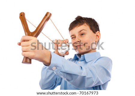 Portrait of a schoolboy sending notes or messages with slingshot and a piece of crumpled paper - stock photo