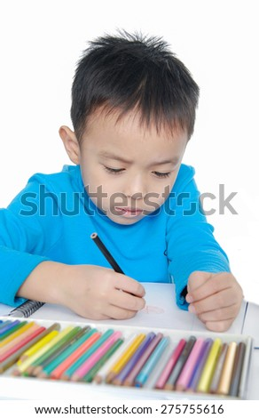 Portrait of a schoolboy sitting with books - stock photo
