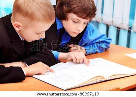 Portrait of a schoolboys in a classroom. - stock photo