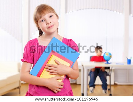 Portrait of a schoolgirl being in a classroom at school. - stock photo