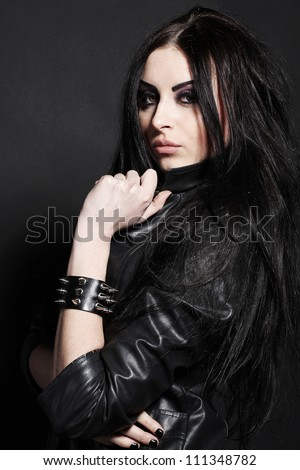 Portrait of a seductive caucasian woman in  a black leather jacket - stock photo