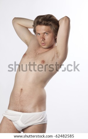 Portrait of a seductive young man in his underwear. Part of  a studio photo series. See more in my portfolio. - stock photo