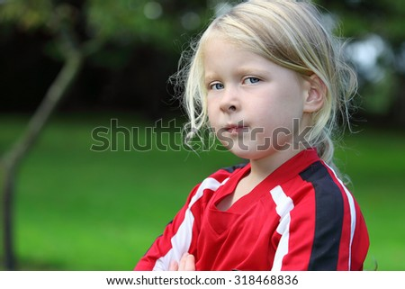 Portrait of a self confident girl in the garden - stock photo
