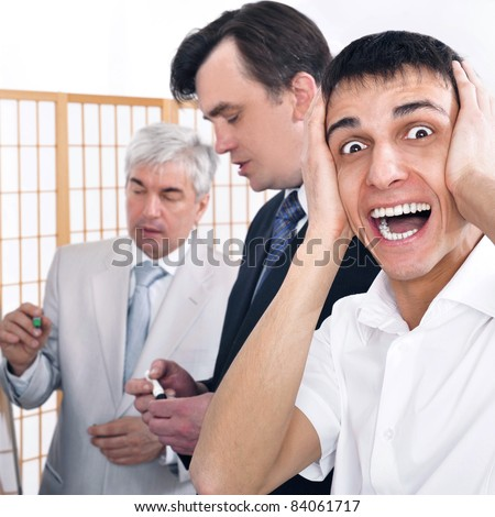 Portrait of a seminar and one man confused. Office background. - stock photo