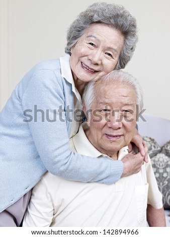 portrait of a senior asian couple. - stock photo