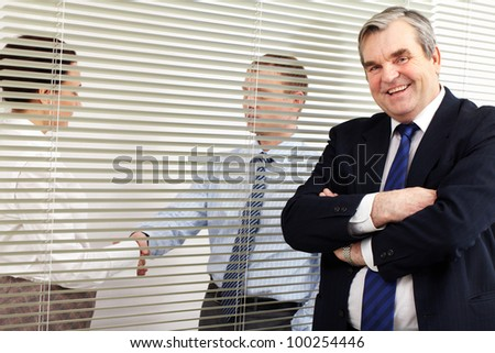 Portrait of a senior chief looking at camera in office - stock photo