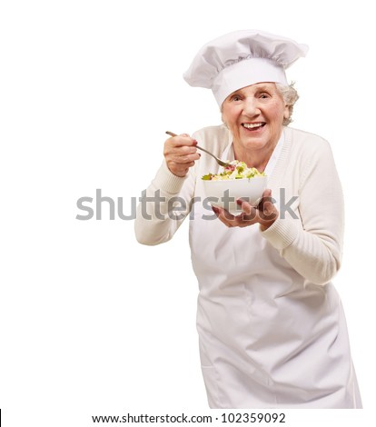 portrait of a senior cook woman eating a salad over a white background - stock photo