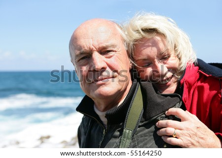 Portrait of a senior couple at seaside - stock photo