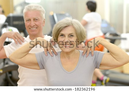 Portrait Of A Senior Couple Exercising in a Gym