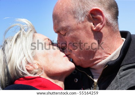 Portrait of a senior couple kissing - stock photo