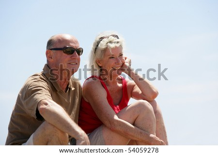 Portrait of a senior couple smiling - stock photo