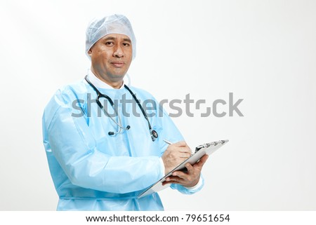 Portrait of a senior doctor writing reports isolated on white background - stock photo