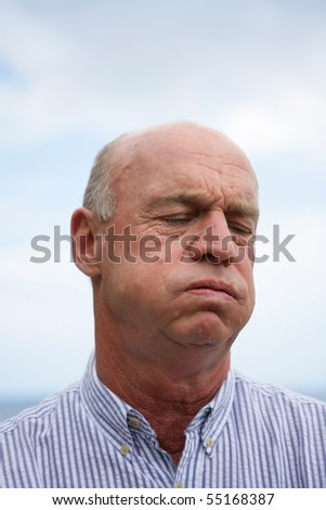 Portrait of a senior grumbling - stock photo