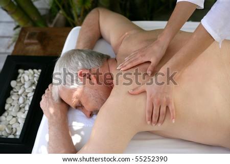 Portrait of a senior man being massaged - stock photo