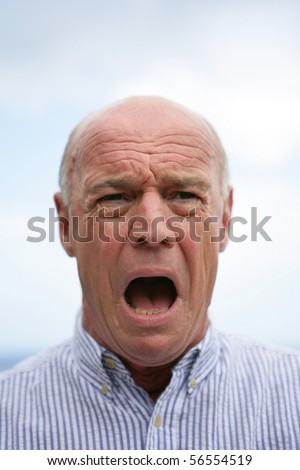Portrait of a senior man in panic - stock photo