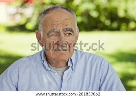 Portrait Of A Senior Man Lost In Thought - stock photo