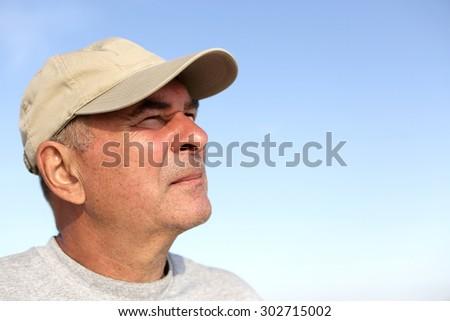 Portrait of a senior man on the sky background - stock photo