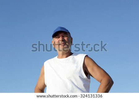 Portrait of a senior man on the sky background - stock photo