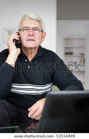 Portrait of a senior man phoning - stock photo