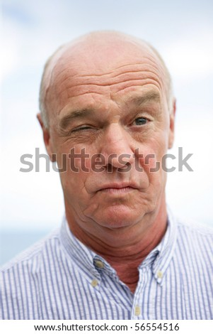 Portrait of a senior man skeptical - stock photo