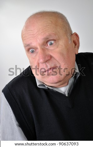 portrait of a senior man with puzzled expression - stock photo