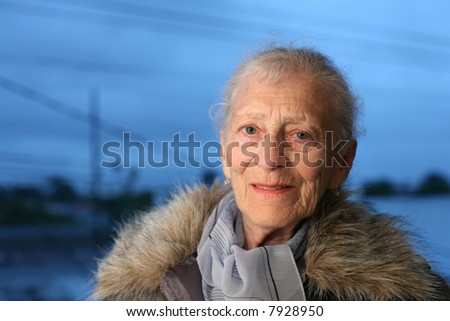 Portrait of a senior woman at winter - stock photo