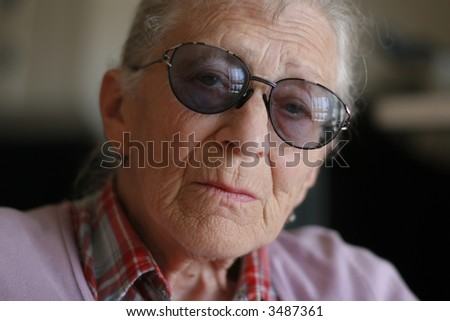 Portrait of a senior woman, close-up. Shallow DOF. - stock photo