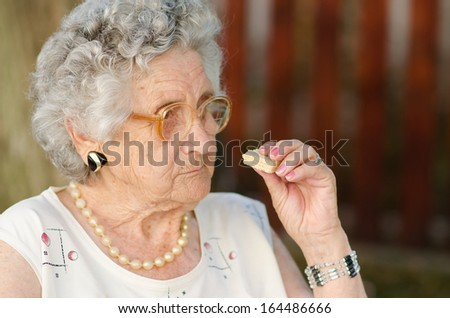 portrait of a senior woman eating - stock photo