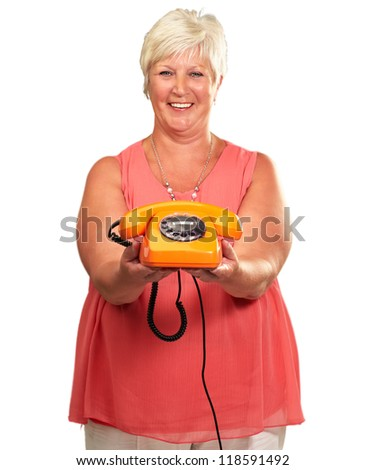 Portrait Of A Senior Woman Holding A Retro Phone On A White Background - stock photo
